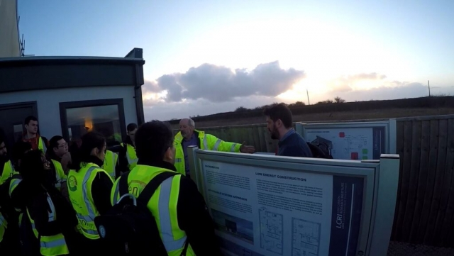 Dr Huw explaining the electrical storage of the house (Tesla battery)