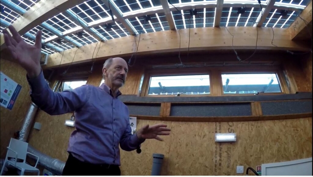Dr Huw shows the students the PV rays on the roof