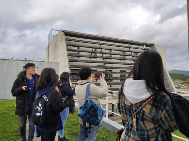 Students on the roof of the Cener National Renewable Energy Centre building