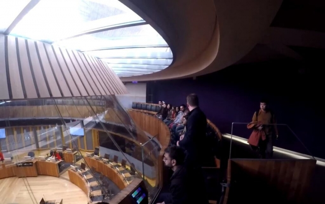 Students in the public gallery of the parliament meeting room