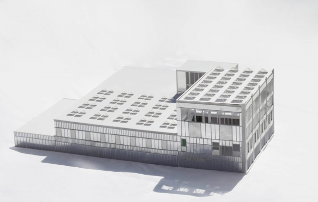 a model of the printworks showing the exterior which is clad of corrugated and perforated metal