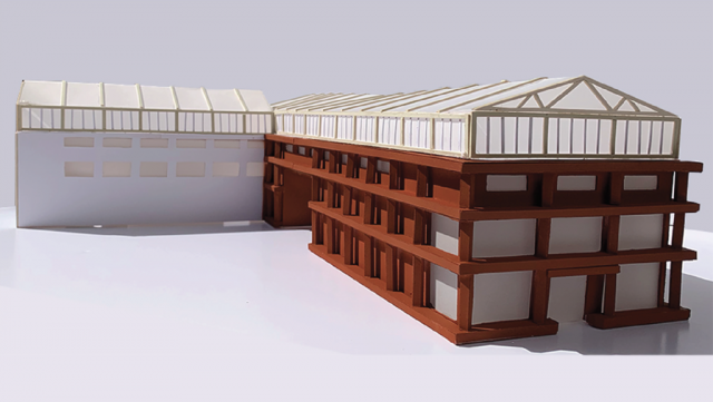 physical model showing the initial building and new extention made in a rusty orange material