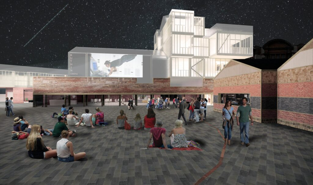 A view towards the proposed scheme from the public realm. This space can be used communally for events and festivals - as the image shows, or as an outdoor cinema.
