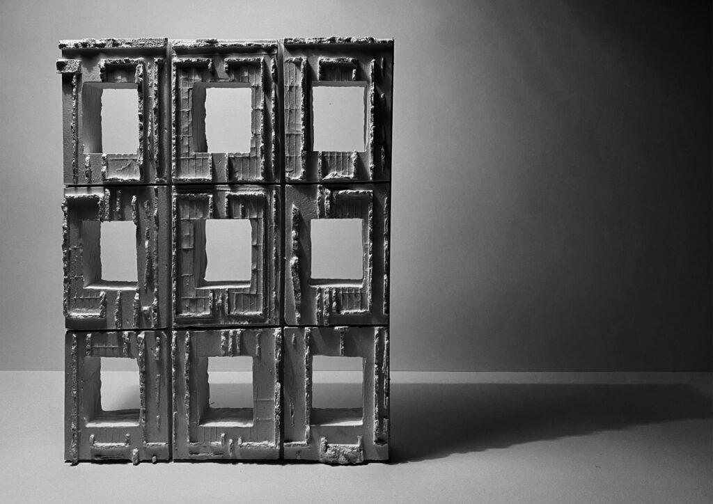 A cast model focusing on the building's facade, using preservation, provocation and celebration to invert and cast the internal room elevations onto the external concrete walls.