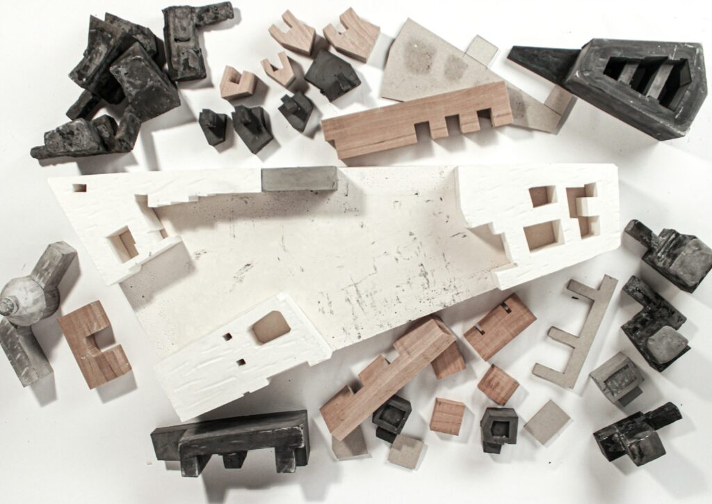 A deconstructed aerial photo of the massing model showing development and evolution of the project.