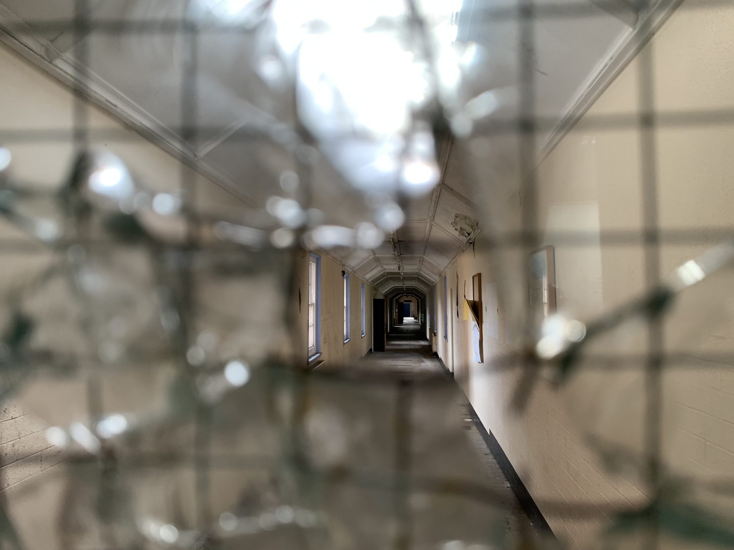 View through wired glass to abandoned corridor