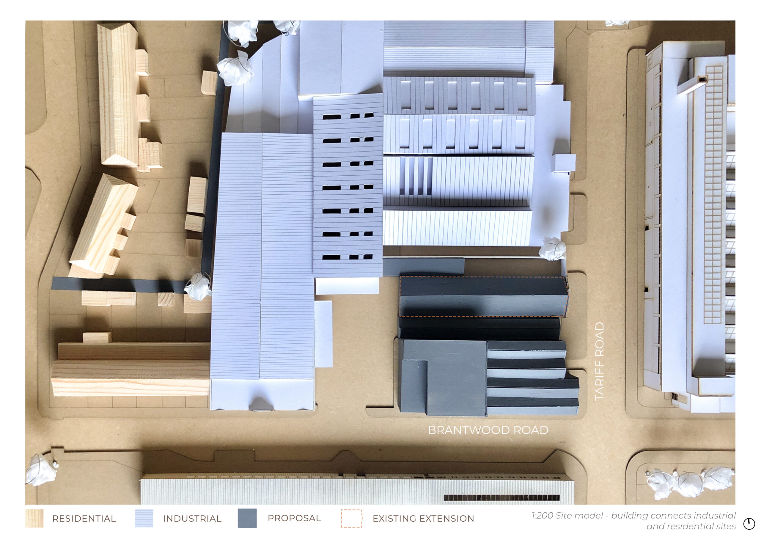 massing model showing the existing industrial buildings in white and the new leatherworks in black. The base is MDF