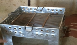 A handmade coal stove made from metal