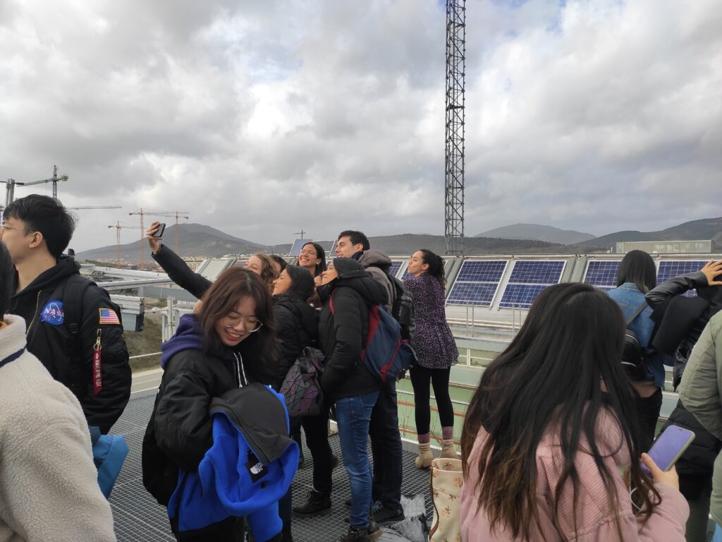 Student looking at PV technology at the roof of the Cener National Renewable Energy Centre building