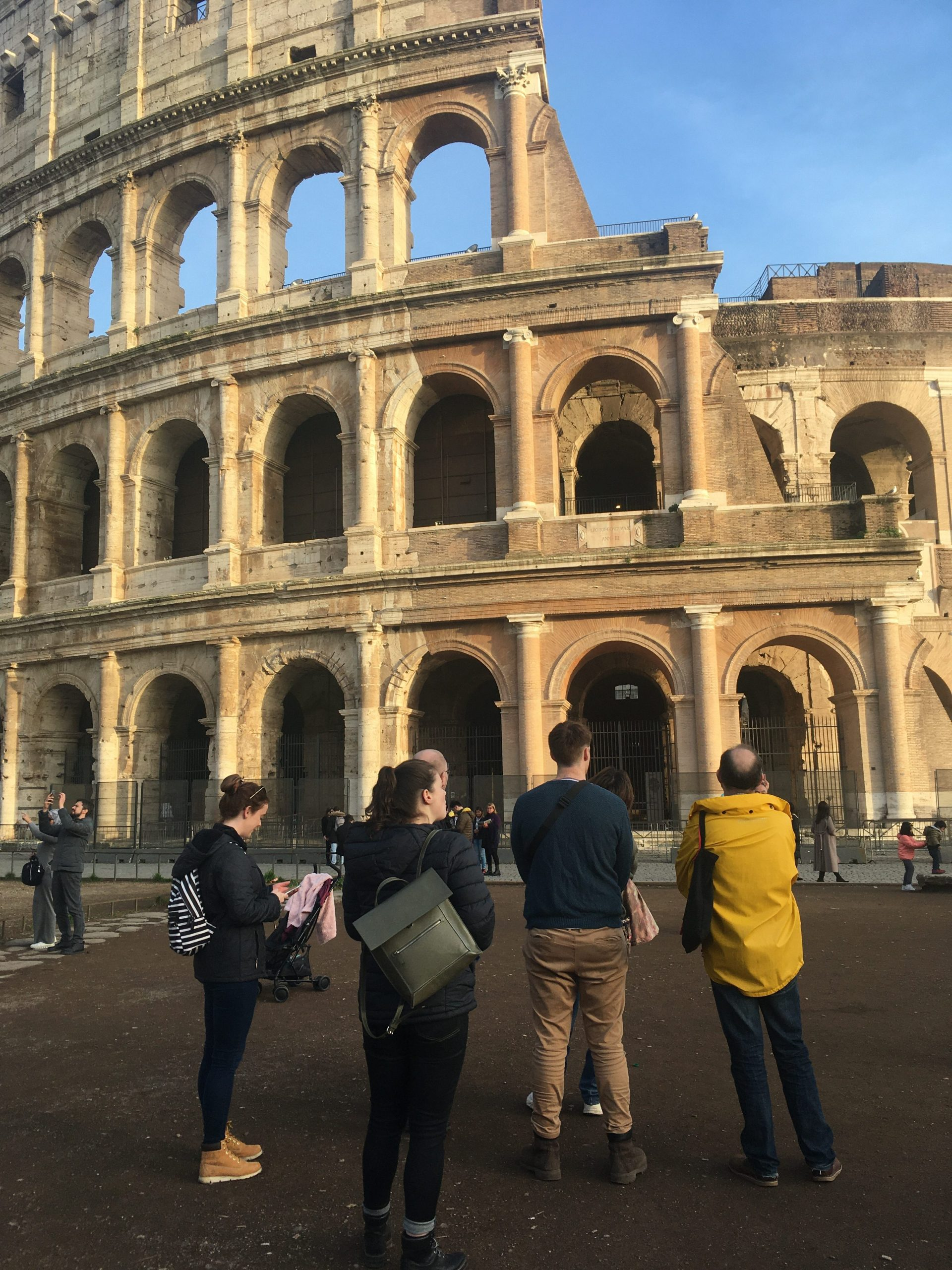 Students and staff contemplating repairs to olosseum, Rome