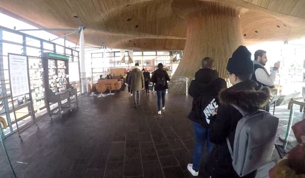 Students walking inside the Senedd building