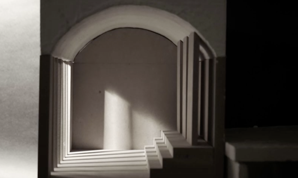 Plaster and wood interior model with columns on the right and steps on the left